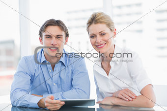Smiling businessman and woman at office