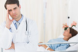 Worried doctor with patient in hospital