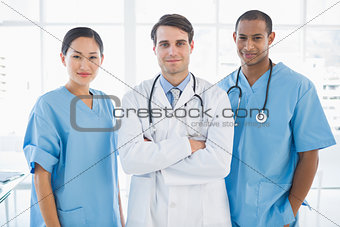 Three doctors standing together at hospital