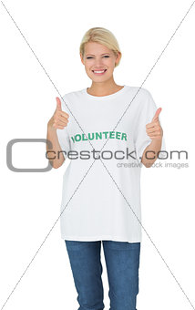 Portrait of a happy female volunteer gesturing thumbs up
