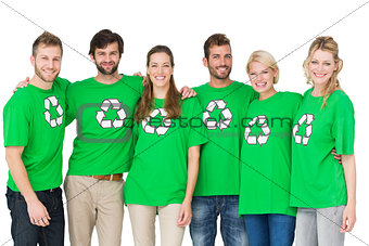 Group portrait of people wearing recycling symbol tshirts