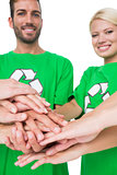 People in recycling symbol tshirts with hands together