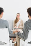 Blurred female financial adviser in meeting with couple