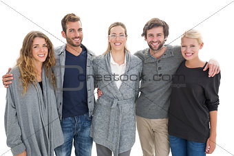 Group portrait of happy people standing with arms around