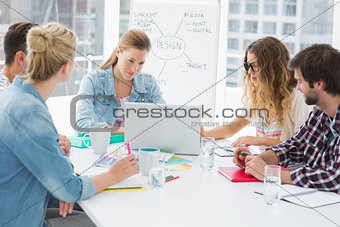 Casual business people around conference table in office