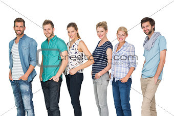 casual happy people standing with hands in pockets