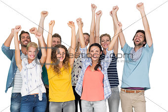 Portrait of casual cheerful people raising hands