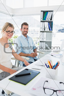 Smiling casual young couple with computer