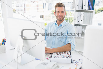 Portrait of a male photo editor working on computer