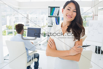 Casual female artist with colleague in background