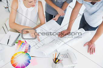 Mid section of artists working on designs