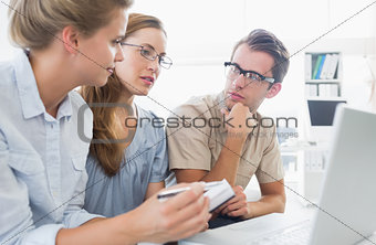 Three young people working on computer
