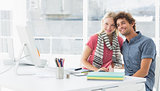 Smiling casual business couple in a bright office