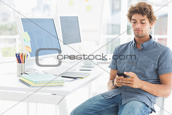 Man text messaging in a bright office