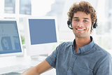 Smiling casual man with headset in the office