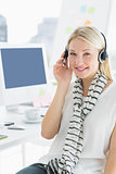 Smiling casual woman with headset in office