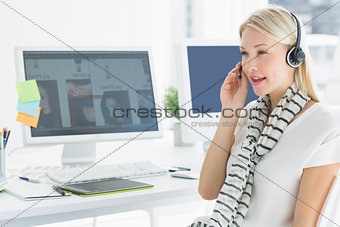 Casual young woman with headset in office
