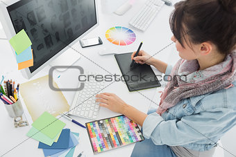 Artist drawing something on graphic tablet at office