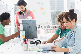 Artists working at desk in the creative office