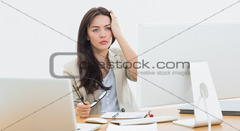 Casual business woman in front of computer at office