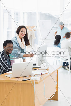Artists working at desks in creative office