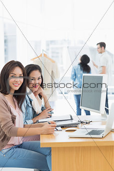 Female artists working at desk in creative office