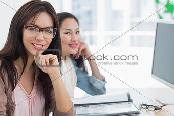 Casual female artists working at desk in office