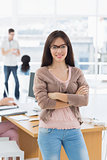 Female artist with colleagues in the background at office