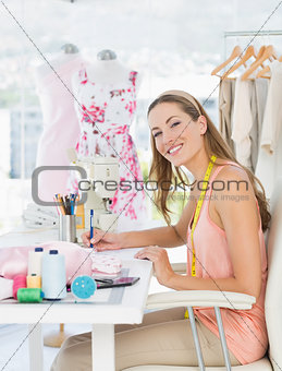 Portrait of a fashion designer working on her designs