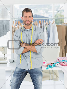 Handsome male fashion designer with arms crossed