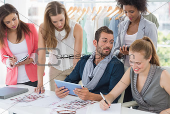 Fashion designers discussing designs