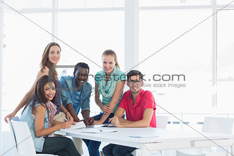 Group portrait of casual artists working on designs