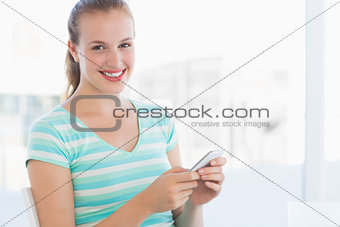 Portrait of a beautiful young woman text massaging