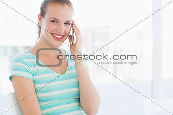 Portrait of a beautiful young woman using mobile phone