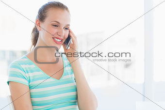Beautiful young casual woman using mobile phone