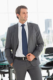 Handsome young businessman in office