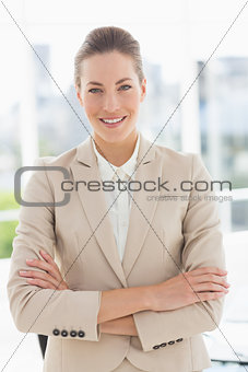 Portrait of a young businesswoman with arms crossed smiling