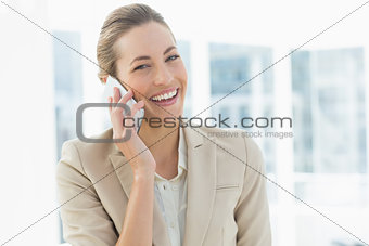 Portrait of a young businesswoman using mobile phone