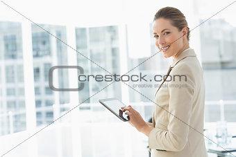 Beautiful businesswoman using digital tablet in office