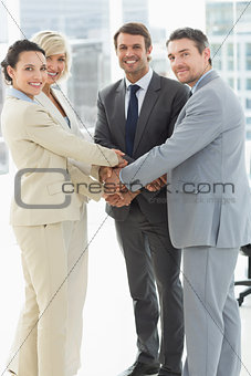 Portrait of business team joining hands together