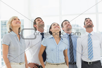 Business team looking up in office