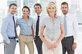 Confident business team together in office
