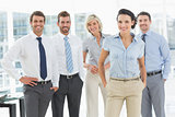 Confident smiling business team in office