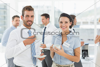 Business colleagues with tea cups during break
