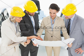 Engineer coworkers discussing a project