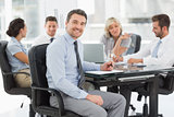 Young businessman with colleagues discussing in office