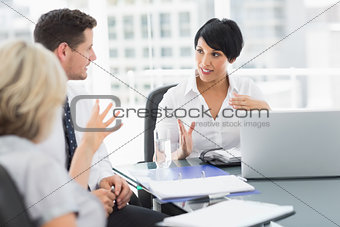 Business people in discussion at office
