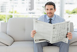 Portrait of a well dressed man reading newspaper