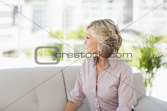 Thoughtful mature woman at home