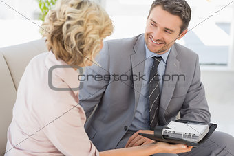 Businessman and his secretary  with diary at home
